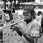 Children at the Mana Rescue Home  (an orphanage for 30 HIV+ children) play band instruments and march together.