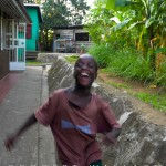 Child at the Mana Rescue Home  (an orphanage for 30 HIV+ children) plays energetically.