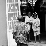 Two boys ring a bell to call the children in to receive their medication at the Mana Rescue Home - an orphanage for 30 HIV+ children.