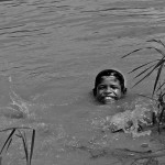 A boy splashes in Tonle Sap Lake, the largest body of water in Southeast Asia.