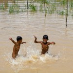 Two boys play in the Tonle Sap Lake, Cambodia.