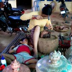 This entire village hammered copper bowls and plates as a source of income. A child sleeps despite the noise.